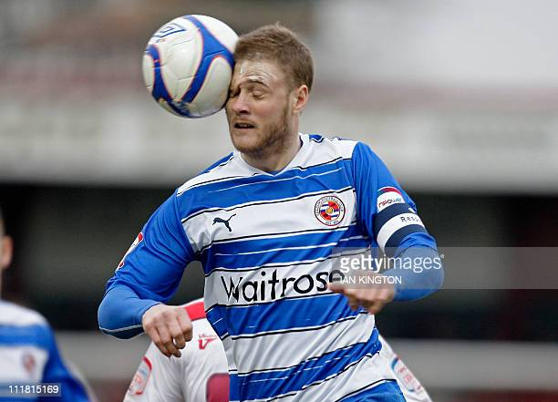 Reading's English defender Matt Mills heads the ball during the FA Cup fourth round football match between Stevenage and Reading at The Lamex Stadium...