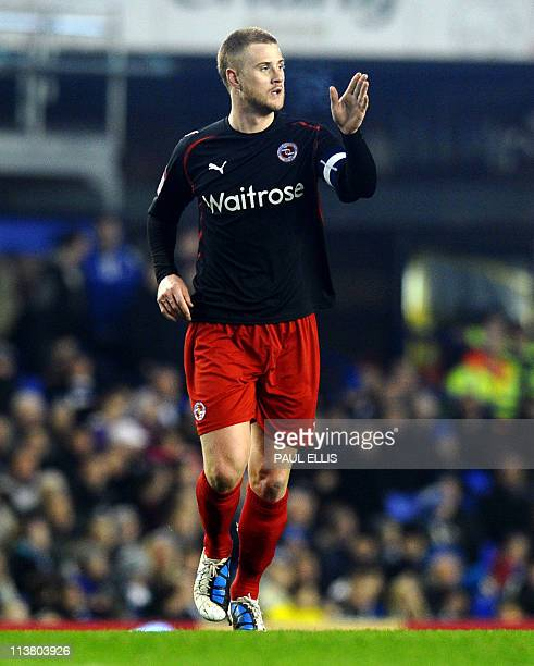 Reading's English defender Matthew Mills celebrates after scoring against Everton during their English FA Cup fifth round football match at Goodison...