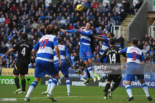 Reading's English defender Sean Morrison jumps for the ball during the English Premier League football match between Reading and Norwich City at The...