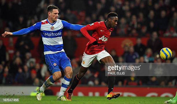 Reading's English defender Sean Morrison pulls back Manchester United's English striker Danny Welbeck during the English FA Cup fifth round football...