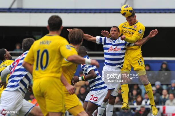 Reading's English defender Sean Morrison vies with Queens Park Rangers' English defender Anton Ferdinand during the English Premier League football...