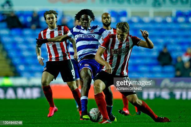 Reading's English midfielder Ovie Ejana vies with Sheffield United's Norwegian midfielder Sander Berge during the FA cup fifth round football match...