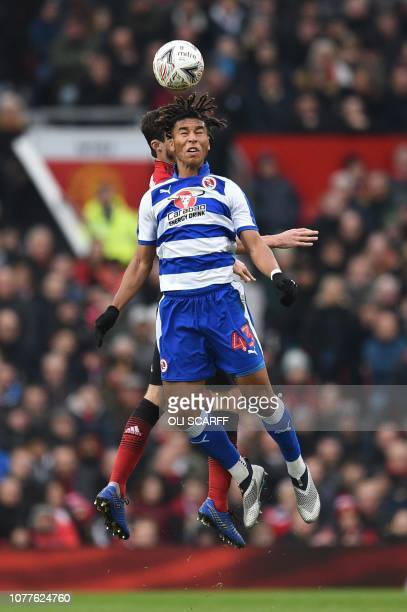 Reading's English striker Danny Loader goes up for a header during the English FA Cup third round football match between Manchester United and...