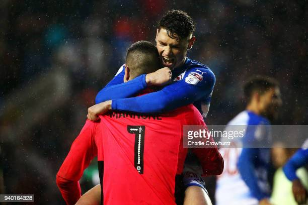 Reading's George Evans celebrates with Vito Mannone after he saves a penalty during the Sky Bet Championship match between Reading and Queens Park...