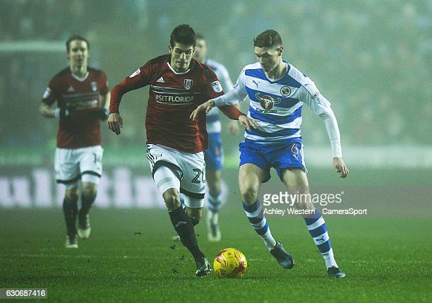 Reading's George Evans holds off the challenge from Fulham's Zakaria Labyad during the Sky Bet Championship match between Reading and Fulham at...