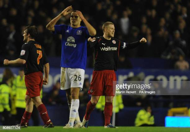 Reading's goalscorer Matt Mills celebrates as Everton's Jack Rodwell shows is dejection at the end of the game during the FA Cup Fifth Round match at...