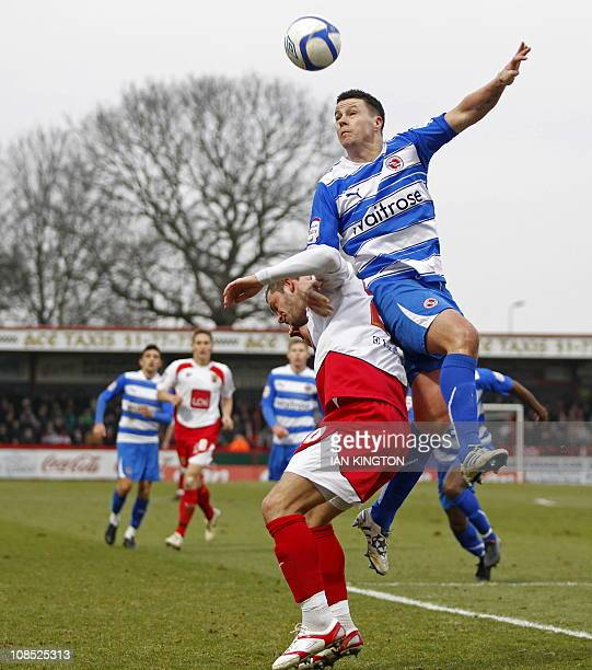 Reading's Irish defender Ian Harte vies with Stevenage's English striker Chris Beardsley during the FA Cup fourth round football match between...