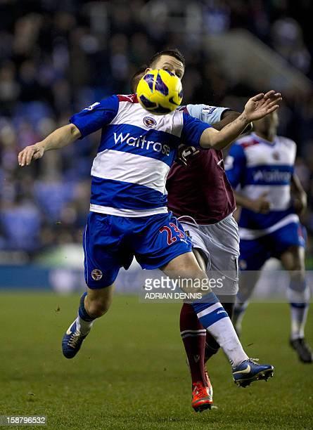 Reading's Irish defender Ian Harte vies with West Ham United's Portuguese striker Ricardo Vaz Te during the English Premier League football match...