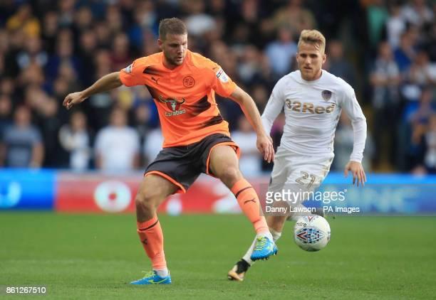 Reading's Joey van den Berg and Leeds United's Samuel Saiz battle for the ball during the Sky Bet Championship match at Elland Road Leeds