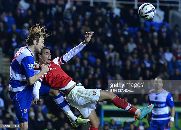 Reading's Latvian defender Kaspars Gorkss vies with Arsenal's Moroccan striker Marouane Chamakh during the English League Cup Fourth Round football...