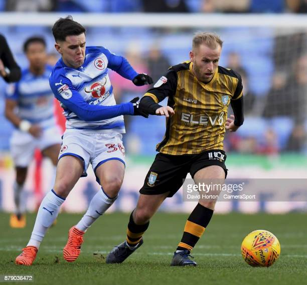 Reading's Liam Kelly battles with Sheffield Wednesday's Barry Bannan during the Sky Bet Championship match between Reading and Sheffield Wednesday at...