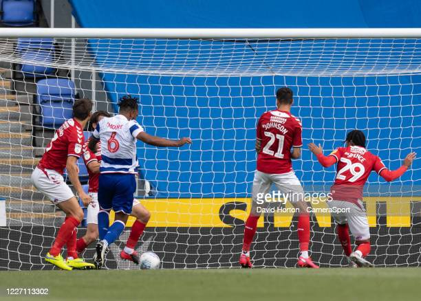 Reading's Liam Moore about to scores his side's first goal during the Sky Bet Championship match between Reading and Middlesbrough at Madejski...