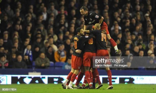 Reading's Matt Mills celebrates scoring his sides opening goal with team mates during the FA Cup Fifth Round match at Goodison Park Liverpool