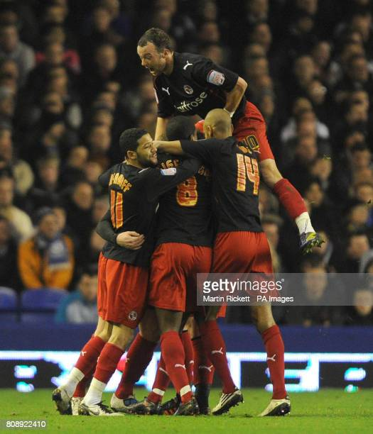 CROP* Reading's Matt Mills celebrates scoring his sides opening goal with team mates during the FA Cup Fifth Round match at Goodison Park Liverpool