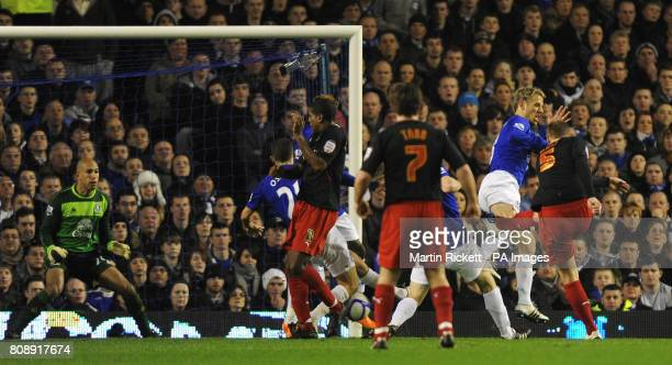 Reading's Matt Mills scores his sides opening goal during the FA Cup Fifth Round match at Goodison Park Liverpool