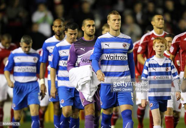 Reading's Matthew Mills leads his players out before kick off