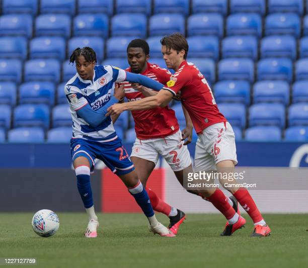 Reading's Michael Olise under pressure from Middlesbrough's Anfernee Dijksteel and Middlesbrough's Jonathan Howson during the Sky Bet Championship...