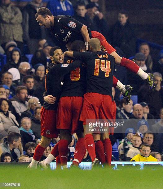 Reading's players celebrate after English defender Matthew Mills scored against Everton during their English FA Cup fifth round football match at...