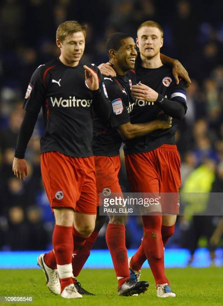 Reading's players congratulate English defender Matthew Mills on scoring against Everton in their English FA Cup fifth round football match at...