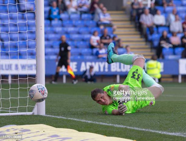 Reading's Rafael dives to cover Blackburn Rovers' Bradley Johnson shot at goal during the Sky Bet Championship match between Reading and Blackburn...