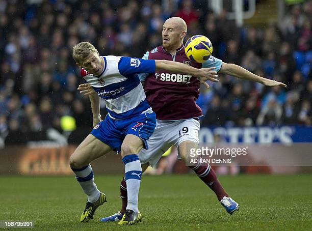 Reading's Russian striker Pavel Pogrebnyak vies with West Ham United's Welsh defender James Collins during the English Premier League football match...