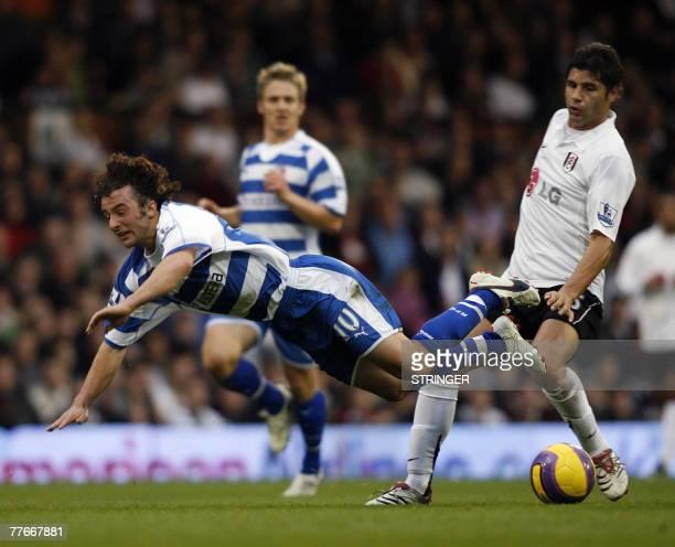 Reading's Stephen Hunt is fouled by Fulham Dejan Stefanovic during their Premiership match at Craven Cottage in west London, 03 November 2007. AFP...