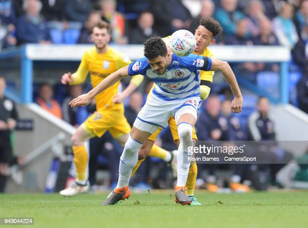 Reading's Tiago Ilori under pressure from Preston North End's Callum Robinson during the Sky Bet Championship match between Reading and Preston North...