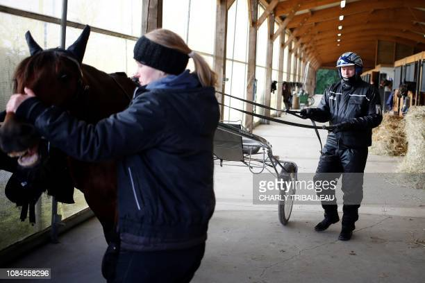 Readly Express and his trainer Timo Nurmos are seen ahead of a training session on January 18 2019 in Mortrée northwestern France