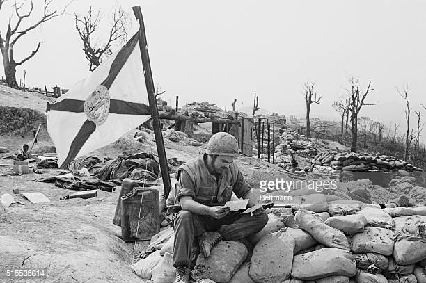 Reads Letter Hill 881 South Vietnam Sgt Joseph Michael Jones of Chattahoochee Fla reads mail atop his bunker which files the Florida state flag on...
