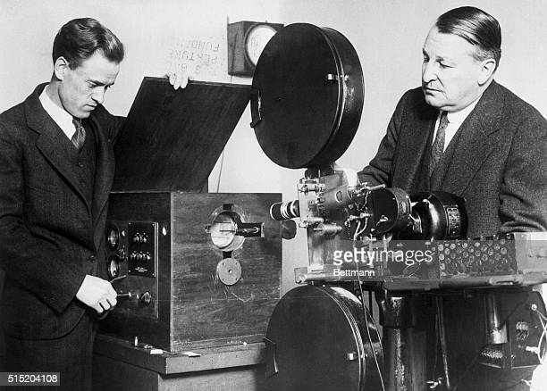1/11/1930ORIGINAL CAPTION READSPhilo Farnsworth demonstrating transmitter of television set to AB Mann consulting engineer His invention said to...