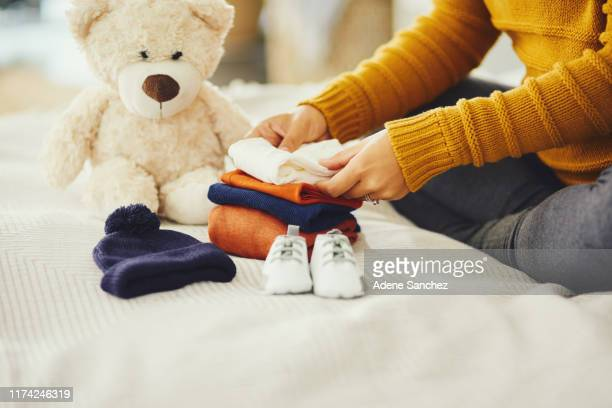 ready and waiting for him to arrive - baby clothing stock pictures, royalty-free photos & images