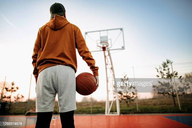 ready for a new match - basketball player stock pictures, royalty-free photos & images