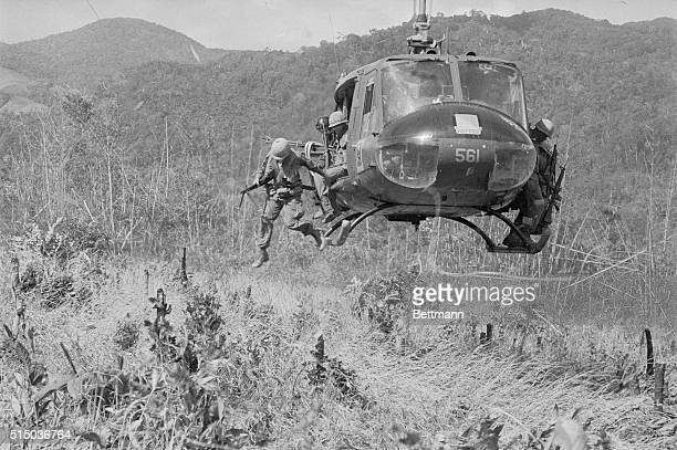 Ready for Action Dak To South Vietnam Members of the US 1st Air Cavalry waste no time in leaving their helicopters on an assault operation 15 miles...