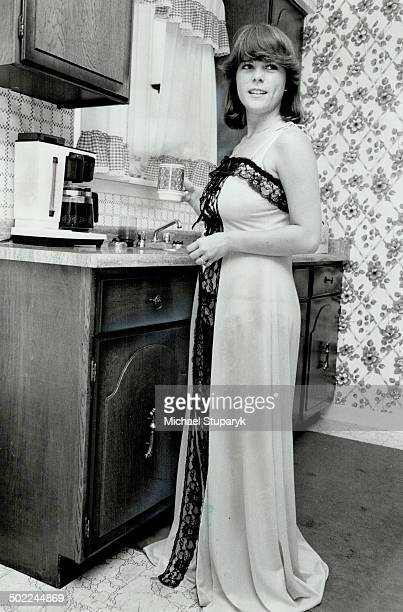 Ready for call Kathy Piper steadies her nerves with a cup of coffee as she awaits call to model lacetrimmed nightgown at a showing of Naughty But...