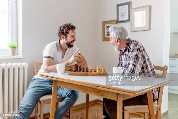 ready for checkmate - game night leisure activity stock pictures, royalty-free photos & images
