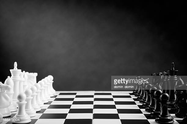 Ready for chess battle on chessboard in black and white