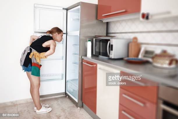 ready for cleaning the fridge - green glove stock photos and pictures
