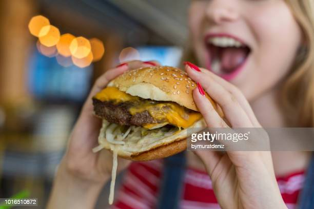 ready for eat hamburger - biting stock pictures, royalty-free photos & images