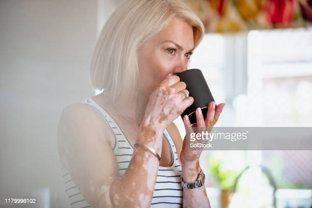 ready for her coffee - mid adult women stock pictures, royalty-free photos & images