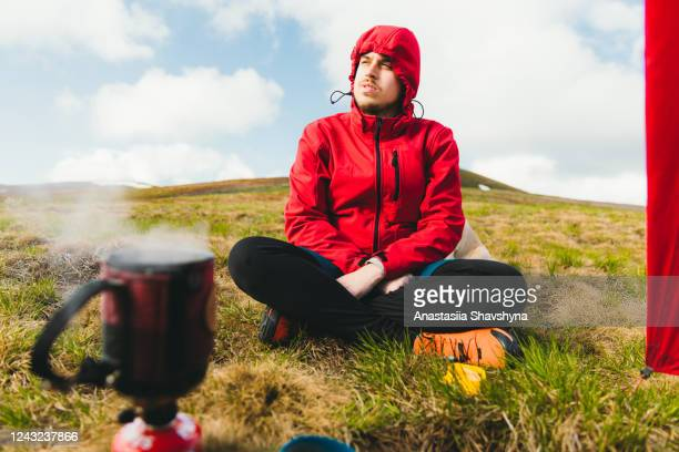 ready for the best outdoor breakfast in the mountains! - red jacket stock pictures, royalty-free photos & images