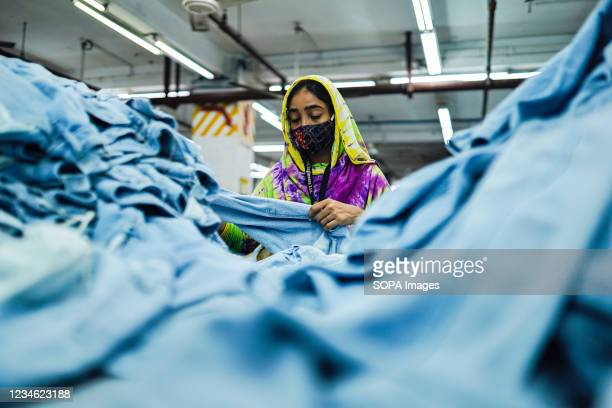Ready Made Garment workers wearing face masks during their work as a precaution against the spread of corona virus.