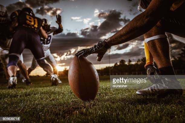 ready, set, kick off! - football player stock pictures, royalty-free photos & images