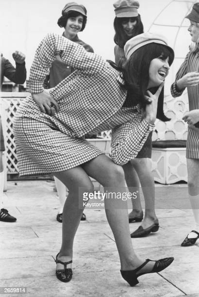 'Ready Steady Goes Live' presenter Cathy McGowan modelling one of the dresses she designed