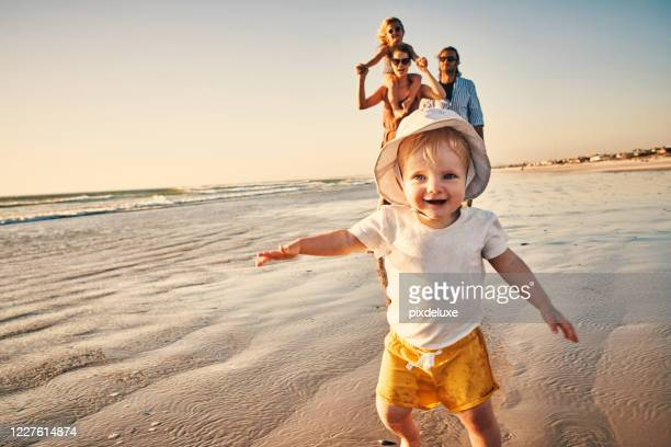 ready, steady…beach! - infant with water stock pictures, royalty-free photos & images