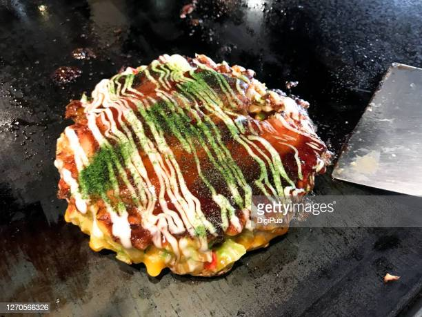 ready to  eat okonomiyaki on griddle - okonomiyaki stock pictures, royalty-free photos & images