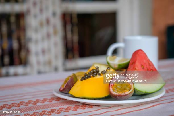 Ready to eat tropical fruit in a plate with a coffee mug on Septembre 19, 2018 in Ruhengeri, Northern Province, Rwanda.
