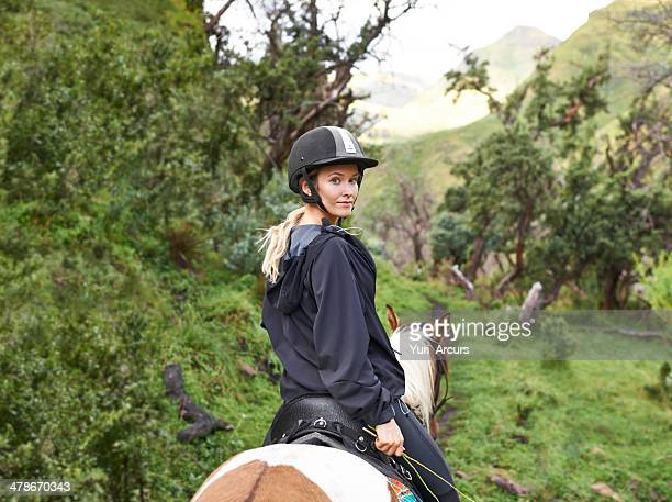 ready to embark on a mountain trail via horseback - riding hat stock pictures, royalty-free photos & images