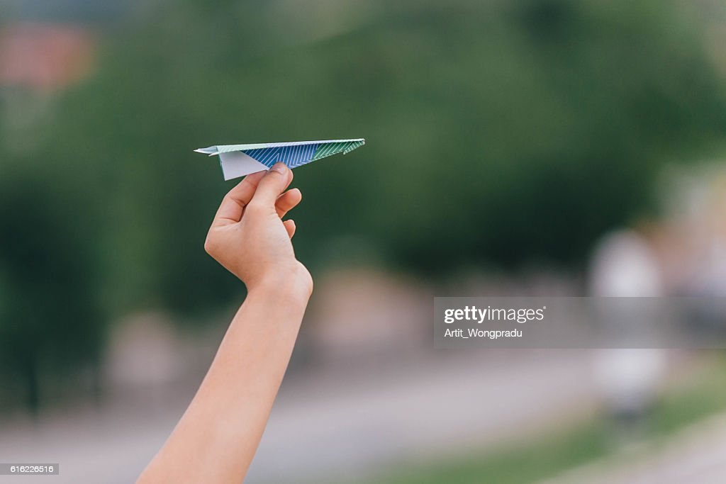 Ready to Fly Colorful Paper Plane with Your Hand : Stockfoto