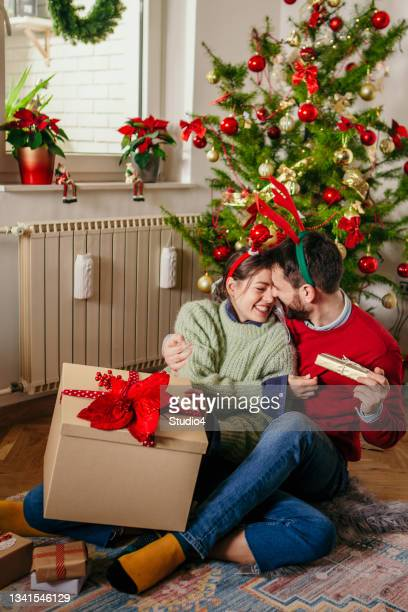 ready to give gifts on this beautiful christmas day - biggest stock pictures, royalty-free photos & images