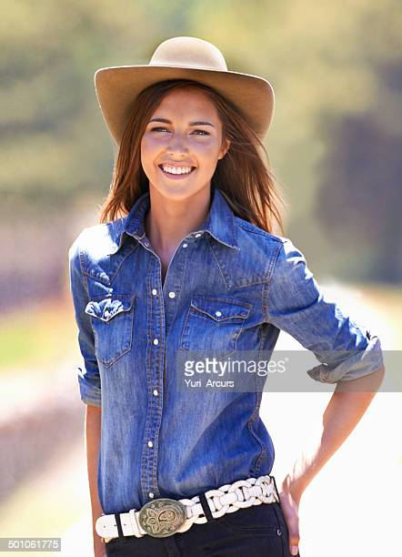 ready to saddle up? - cowgirl hairstyles stock photos and pictures
